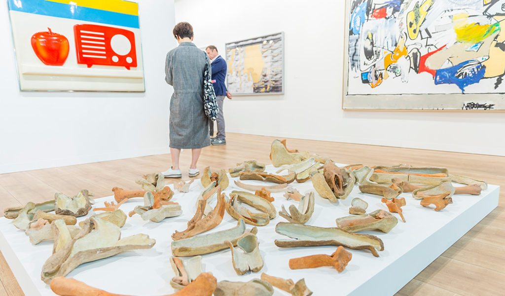 """Mitchell-Innes & Nash booth: Nancy Graves, """"Bones and Their Containers (To Martin Cassidy),"""" 1971 (front) & Tom Wesselmann, """"Still Life #53,"""" 1964 (left) (© Art Basel )"""