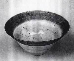 Bowl, Lucie Rie, circa 1960. Porcelain; 9.5 in diameter.  One of Britian's potters, the Vienna-born Rie moved to London in 1938, where she exerted an influence on the postwar generation of ceramists.  Sgrafitto rims and monochrome glazes characterize many of her bowls.  Image courtesy Galerie Besson, London