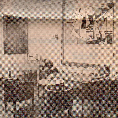 """Another view of the sitting room, with Roy Lichtenstein's """"Sailboats."""" 1974 over the couch and Jasper Johns' """"Screen Piece,"""" 1967."""
