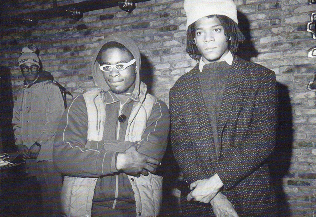 The son of a successful businessman, Basquiat nonetheless cultivated and image of untutored street graffitist.  But the streets he stategically chose for his SAMO tag were in Soho and the East Village.   Here, Basquiat (right) with a fellow hip-hopper, 1982