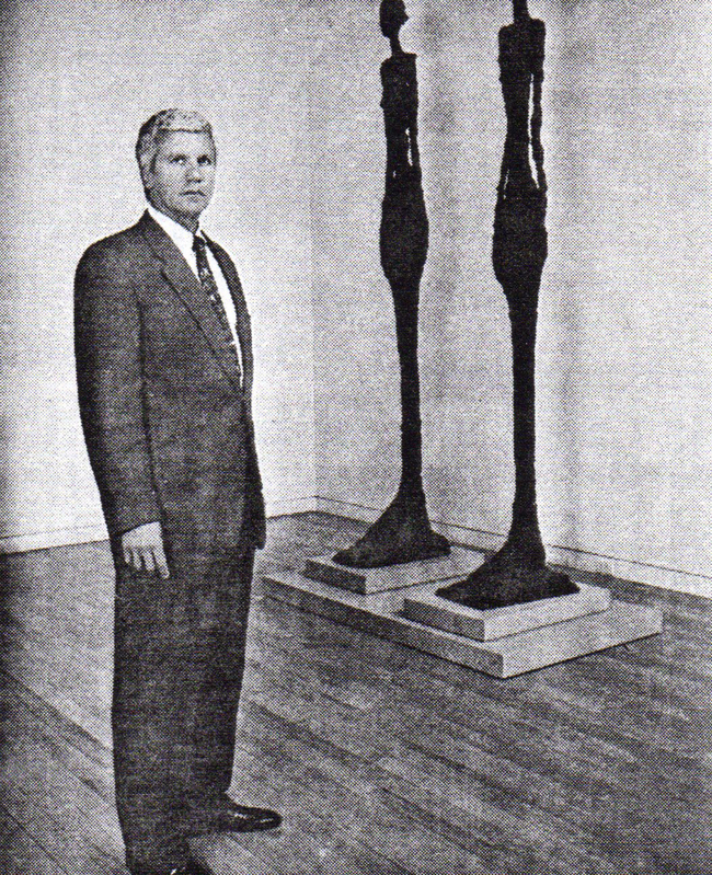 Art dealer, Larry Gagosian next to a pair of Giacometti sculptures at his Madison avenue gallery.  Photo by Cori Wells Braun for the Washington Post
