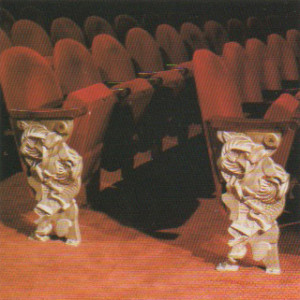 his reliefs on rows of theatre seating