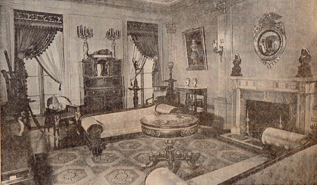 Warhol's back sitting room with painted and stenciled Baltimore center table, circa 1825, and carved and gilded recamiers (couches), circa 1835.